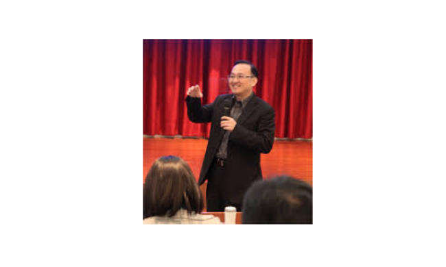 Alston Chang speaking on stage