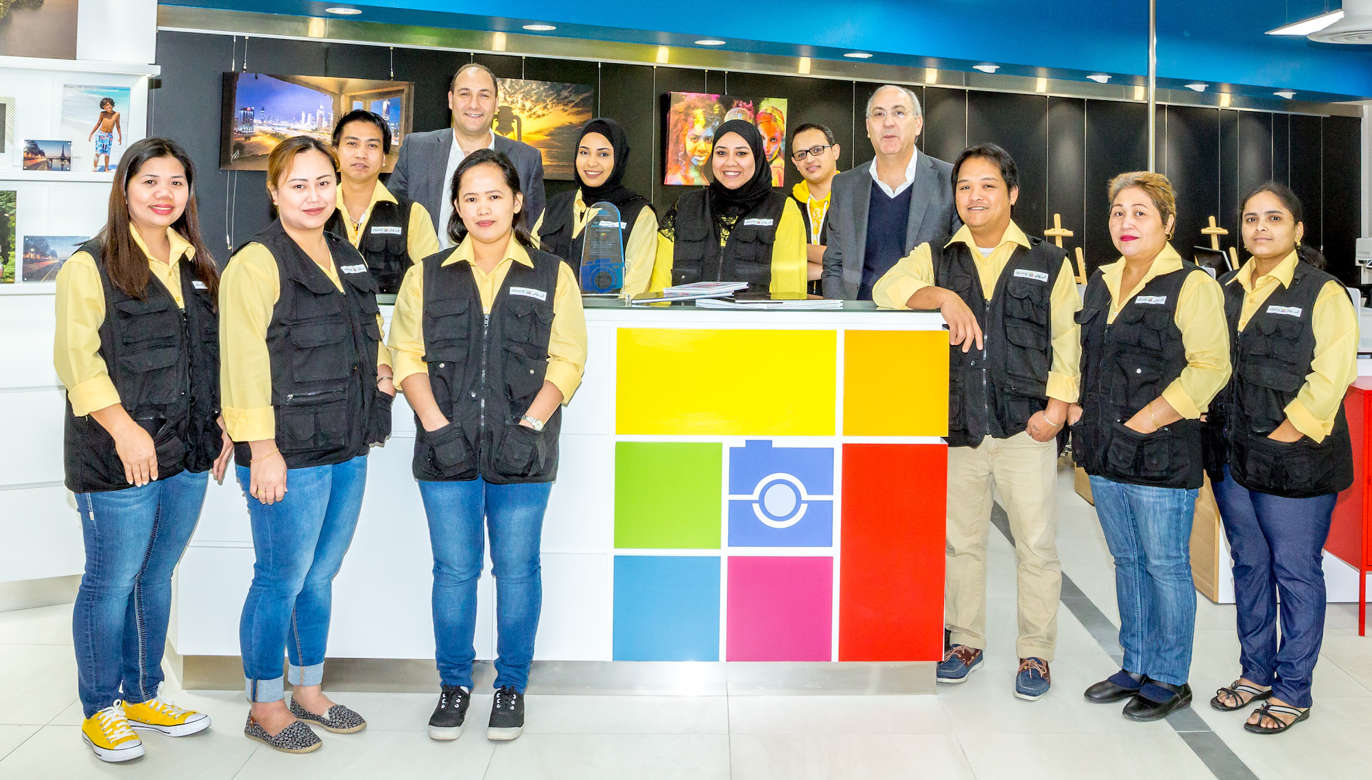 Albumii Team infront standing at store counter