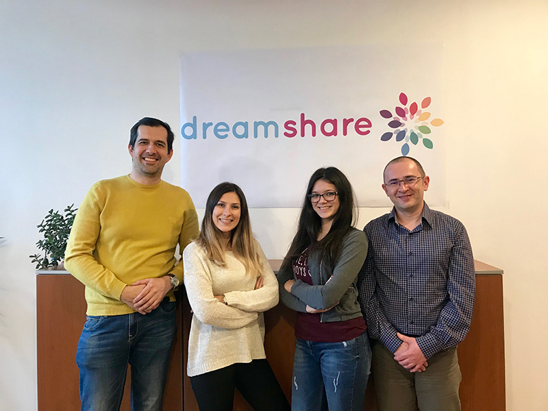 Adrian Marinescu and his team in front of Dream Share Flag
