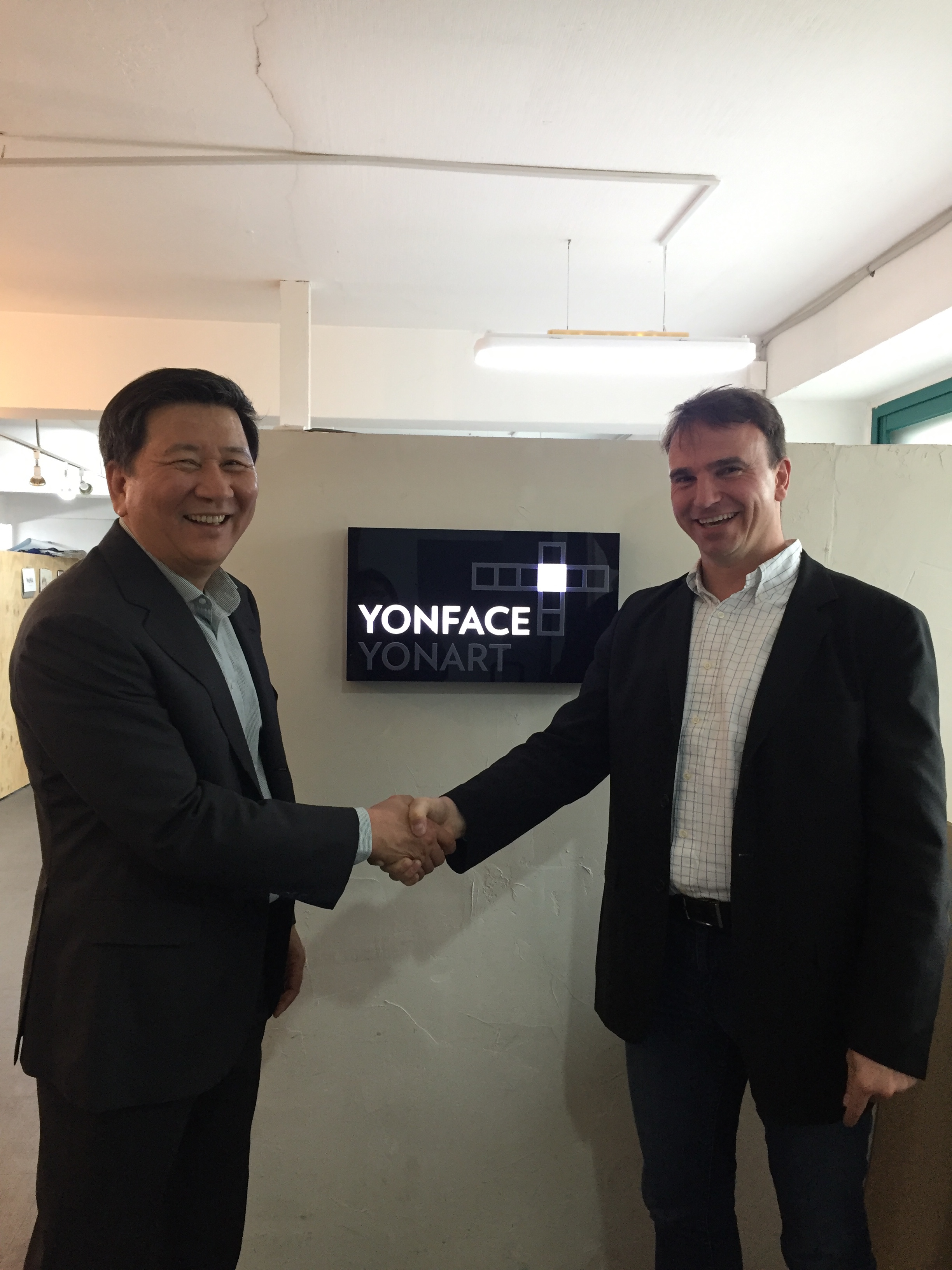 KS Kim, Steffen Haaga shaking hands at YonFace