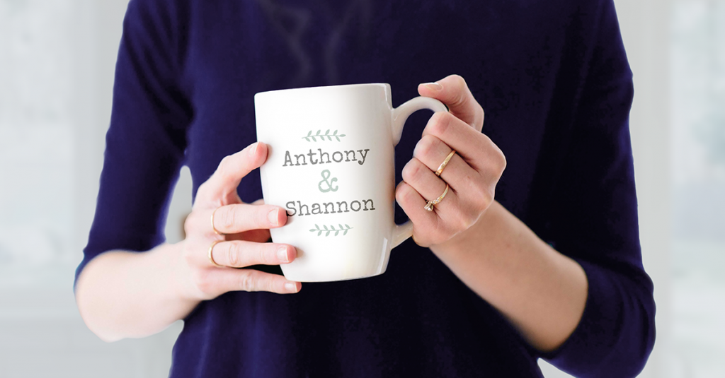 woman's hands holding personalised mug