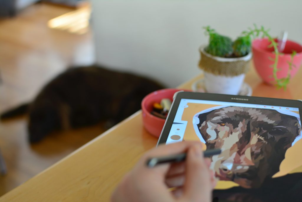 digital drawing of dog on tablet